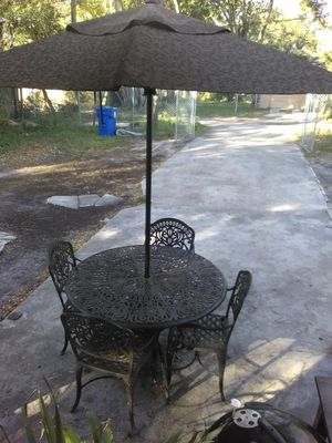 Patio set for $150 comes with the umbrella for Sale in Saint Petersburg, FL