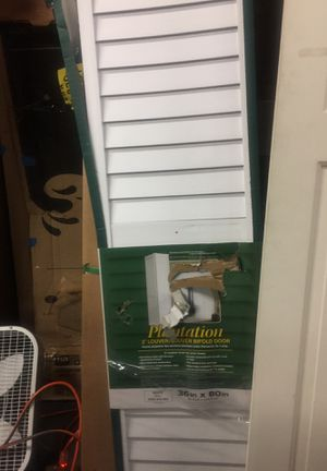 CNinet doors closet for Sale in Lawrenceville, GA