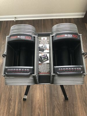 NEW POWERBLOCK ADJUSTABLE DUMBBELLS AND STAND SPORTS SERIES WEIGHT RANGE 10-50 for Sale in Columbus, OH