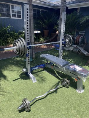 New Bench Press Squat Rack & Weight Set (Curl Bar Not Included) for Sale in Garden Grove, CA