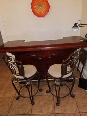 Solid wood wet Bar. Two beautiful matching metal bar stools. Seats fully rotate. for Sale in Shelbyville, KY