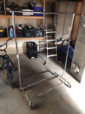Adjustable rolling clothing rack for Sale in Hartford, CT