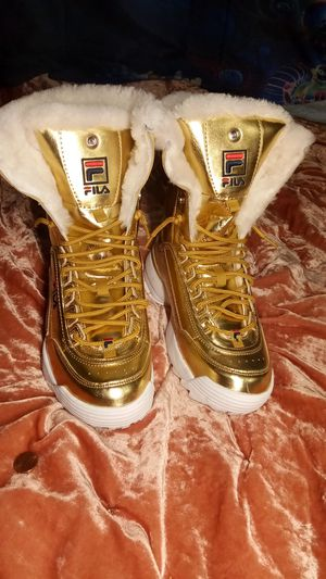 Fila golden mettalic boots for Sale in Seattle, WA