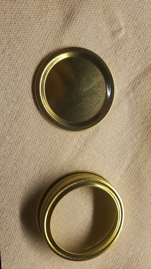 Brand new set of 12 gold lids ( metal bands and inserts) canning jar lids for Sale in Hammond, IN