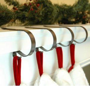 New set of four mantleclip stocking Christmas holders for fireplace for Sale in Henderson, NV