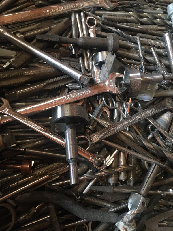 A ton of drill bits, wrenches, and router accessories