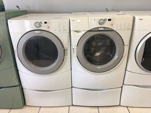 Whirlpool front load washer and dryer set with pedestals for Sale in Orlando, FL