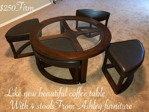Beautiful glass coffee table with four stools from Ashley furniture $250 firm for Sale in Laveen Village, AZ