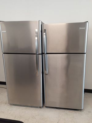 Frigidaire stainless steel top freezer refrigerator in good condition with 90 day's warranty for Sale in Mount Rainier, MD