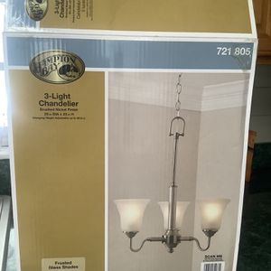 New still in box three light chandelier. Brushed nickel finish. See pic for dimensions. $30 firm. for Sale in Brandon, FL