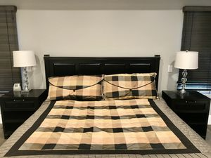 Black Cal king bed including two matching night stands, clean mattress with no spots, box spring, comforter, bed skirt and two king size pillow shams for Sale in Newport Beach, CA