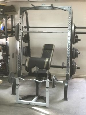 Smith Machine - Workout Station - Lots of weights for Sale in Queen Creek, AZ