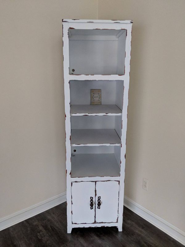 Pair of distressed bookcase towers