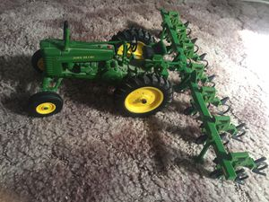 Medal John Deer tractor with attachment for Sale in Buhl, ID