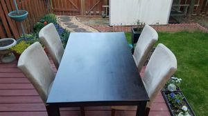 Rectangular brown wooden table with four chairs for Sale in Rockville, MD