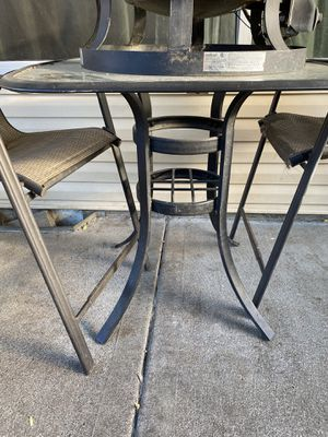 2 patio/outdoor furniture. chairs and table. Bistro height. Has hole for umbrella. for Sale in Hillsboro, OR