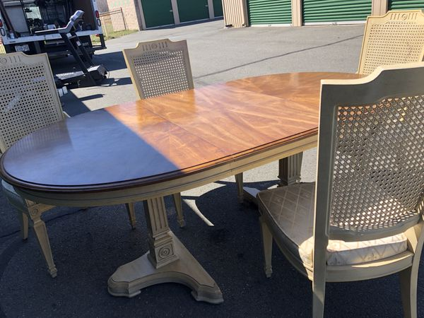 Table w leaf and wicker chairs