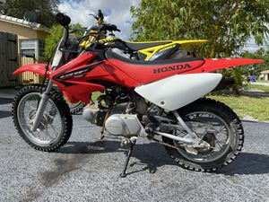 HONDA CRF 70 with title I BUY SELL TRADE DIRT BIKE's & ATV's for Sale in Lauderdale Lakes, FL