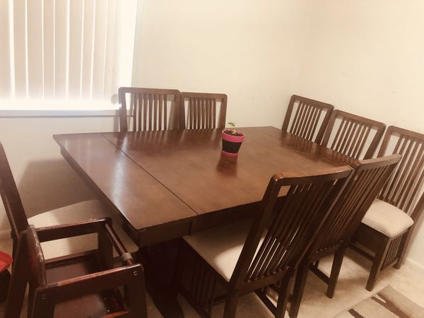Dining table and 8 chairs + table extendable + kid chair