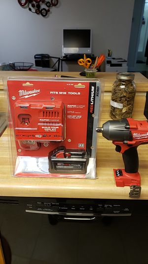 Milwaukee M18 made torque impact wrench and Milwaukee rapid charger With 8.0 battery for Sale in Lompoc, CA