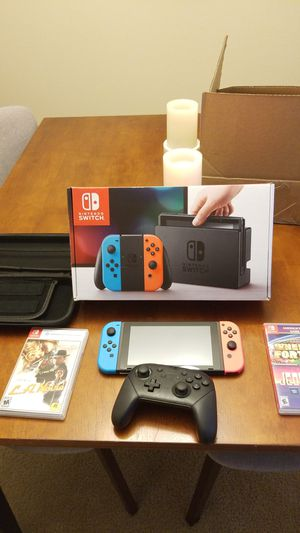 Nintendo Switch with 2 games, PRO Controller & Carrying Case for Sale in Mukilteo, WA