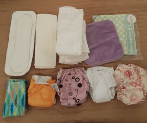 Cloth diapers with microfiber inserts and new reusable wipes size small everything for 5.00 pick up in Fontana for Sale in Fontana, CA