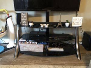 Black glass tv stand for Sale in Lindenhurst, NY