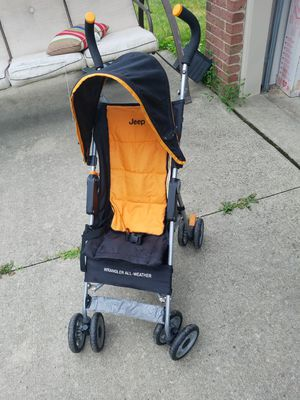 Jeep Wrangler All Weather stroller with canopy for boys or girls, clean, works great for Sale in Dearborn, MI