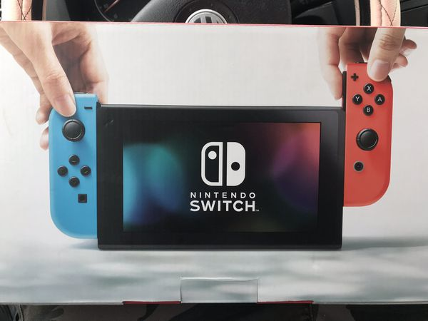 NINTENDO SWITCH BRAND NEW !! NEVER BEEN OPENED!!
