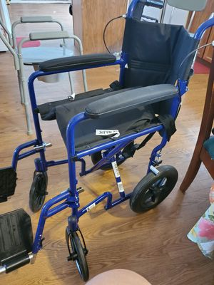 Portable transfer Wheelchair with detachable swing out footrests for Sale in Houghton Lake, MI