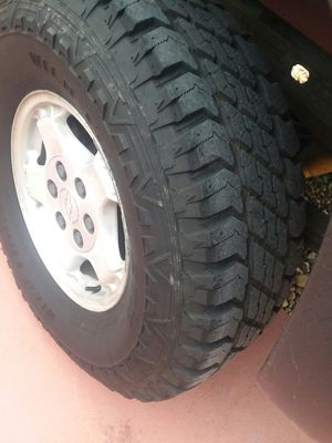 4 tires with rims for Chevy silverado 1500,tires LT285/75R16 with 95% of life. Look new for Sale in Port Richey, FL