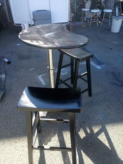 Bistro Bistro breakfast table 41 inches tall x 32 inches wide by 22 inches deep Wood stools are 29 inches tall. for Sale in Tacoma,  WA