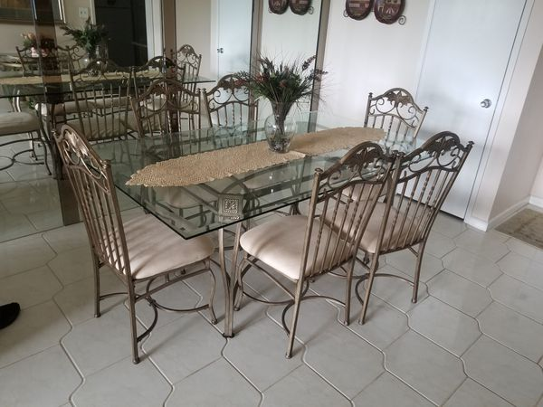 Dinning table glass top. chairs included