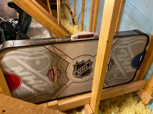 NHL (east vs west) Air hockey Table. Purchased it and played a few games for a family reuinion then stored it brand new for Sale in Las Vegas, NV