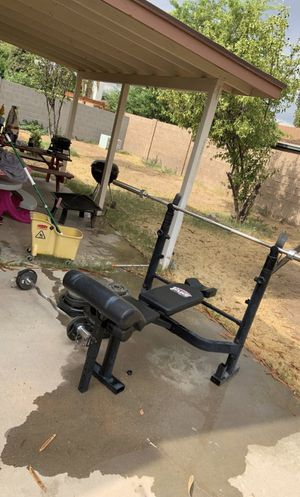 Bench Press and Plates W/ Curl Bar for Sale in Glendale, AZ