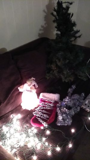 4ft Xmas tree, 2 sets of lights,lighted angle, stocking, 8 silver oartaments and silver tincel wrap the whole kit 20 bucks for Sale in Phoenix, AZ