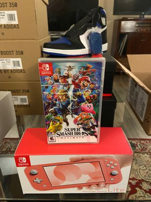 Nintendo Switch Lite Coral with Smash Bro's Bundle Brand New for Sale in Detroit, MI