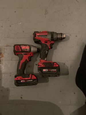 Milwaukee impact and hammer drills with batteries for Sale in St. Louis, MO