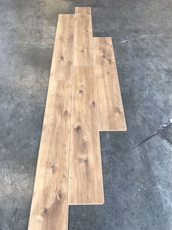 Laminate flooring pad attached