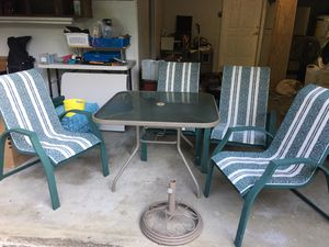 Patio Table and four chairs and umbrella stand for Sale in Lake Stevens, WA