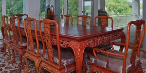 Hand carved Asian rosewood dining room set 114 inches long with 10 chairs, cushions and custom made protective top for Sale in Falls Church, VA