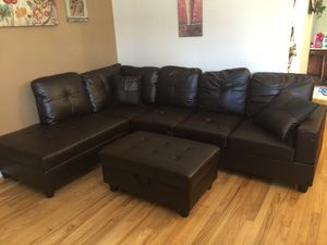 New brown faux leather sectional couch with storage ottoman for Sale in Renton, WA
