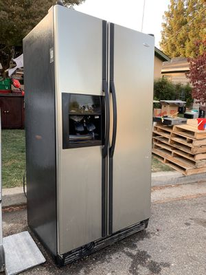 Whirlpool side-by-side refrigerator freezer with ice maker and water dispenser excellent condition for Sale in Modesto, CA