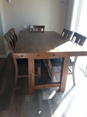 Beautiful wooden Rustic- Counter Height dining table with 6 chairs and buffet table from. Ashley for Sale in Phelan, CA
