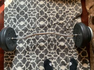Curling bar with weights for Sale in Hesperia, CA