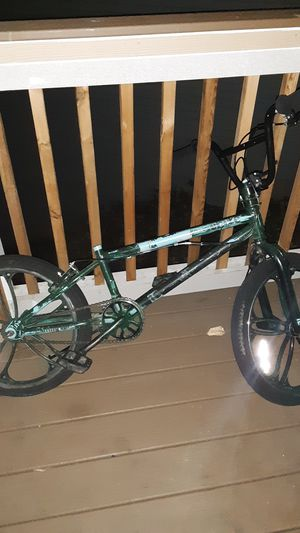 Mixed green Mongoose bmx bike with special costume rims for Sale in Portland, OR