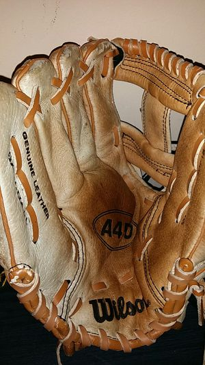 Wilson Genuine Leather Baseball mitt with A450 circled in the middle of the glove and A450 sewn on the outside also. for Sale in New Castle, IN
