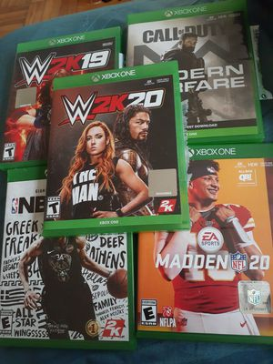Selling my xbox one s has 10 games on it plus 4 in the case for Sale in Washington, DC