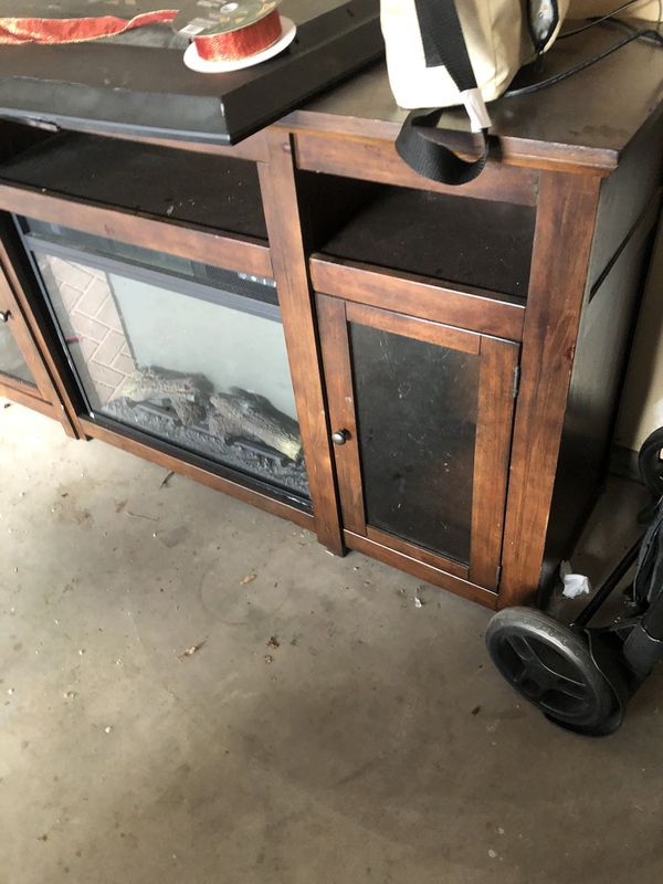 Ashley tv stand with fire screen heater