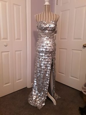 New with tags.. stand out in silver... prom dress for Sale in Cumming, GA
